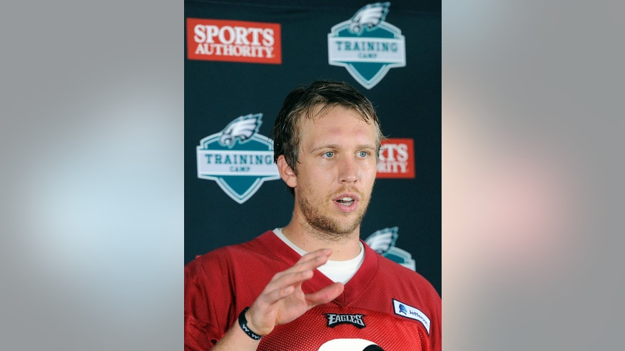 Philadelphia Eagles' Nick Foles speaks to the media during an NFL football training camp on Saturday, July 26, 2014, in Philadelphia. (AP Photo/Michael Perez)