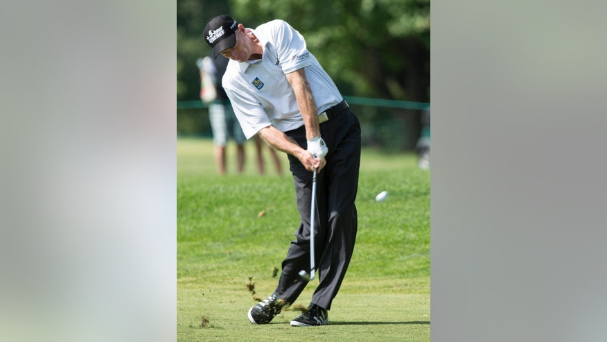 Jim Furyk hits on the ninth fairway during the third round of the Canadian Open golf championship at the Royal Montreal Golf Club in Montreal, Saturday, July 26, 2014. (AP Photo/The Canadian Press, Paul Chiasson)