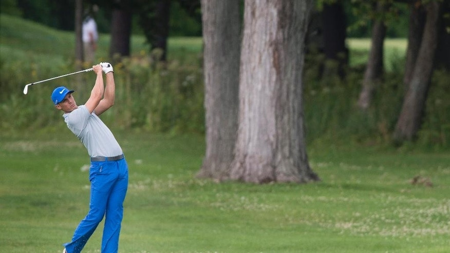 Jamie Lovemark, from the United States, plays a shot from the 18th fairway during the third round of the Canadian Open golf championship at the Royal Montreal Golf Club in Montreal, Saturday, July 26, 2014. (AP Photo/The Canadian Press, Graham Hughes)