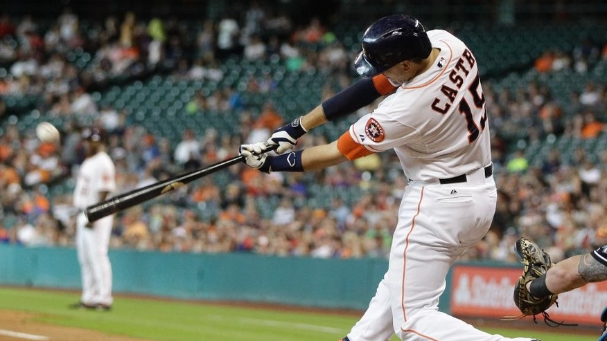Houston Astros' Jason Castro hits a home run during the first inning of a baseball game against the Miami Marlins, Saturday, July 26, 2014, in Houston. (AP Photo/Patric Schneider)