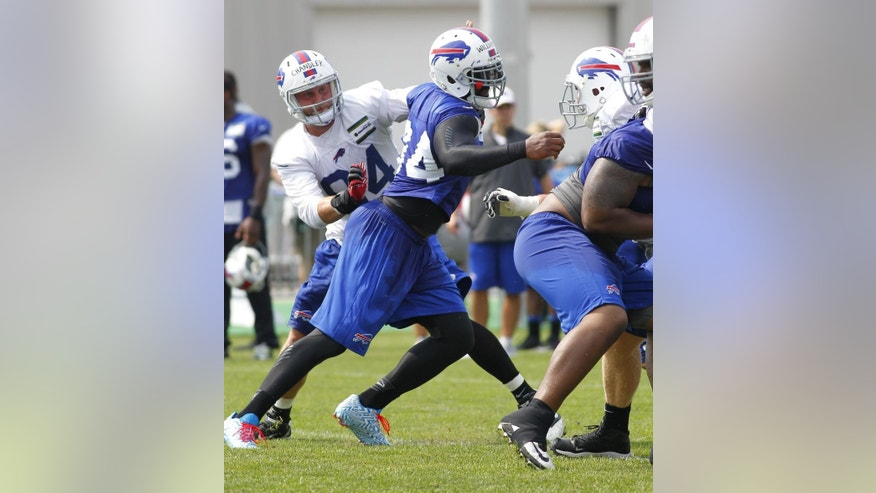 Buffalo Bills defensive end Mario Williams (94) takes part in drills during their NFL football training camp in Pittsford, N.Y., Monday, July 21, 2014. (AP Photo/Bill Wippert)