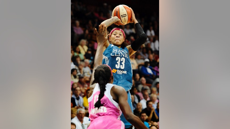 Minnesota Lynx' Seimone Augustus shoots over Connecticut Sun's Chiney Ogwumike, left, during the second half of a WNBA basketball game, Sunday, July 27, 2014, in Uncasville, Conn. The Lynx won 76-65. (AP Photo/Jessica Hill)