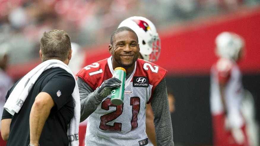 Arizona Cardinals' Patrick Peterson has a laugh during the NFL football team's training camp Saturday, July 26, 2014, in Glendale, Ariz. (AP Photo/The Arizona Republic, Cheryl Evans)