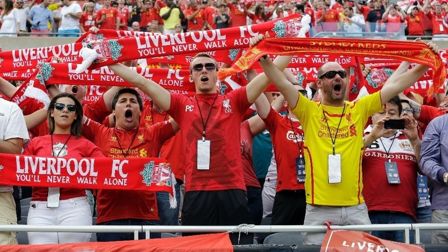 Liverpool FC fans cheer for their team before International Champions Cup soccer match against the Olympiacos in Chicago, Sunday, July 27, 2014. (AP Photo/Nam Y. Huh)