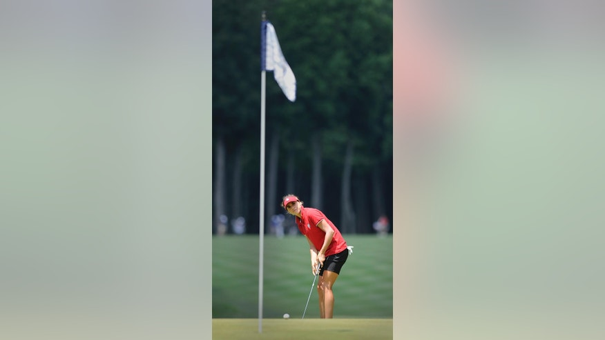 Belen Mozo, of Spain, watches her chip onto the fourth hole during the final round of the International Crown golf tournament Sunday, July 27, 2014, in Owings Mills, Md. (AP Photo/Gail Burton)