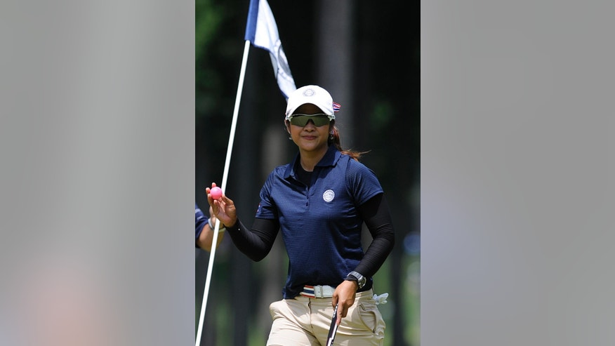 Pornanong Phatlum, of Thailand, smiles after a birdie on the fourth hole during the final round of the International Crown golf tournament Sunday, July 27, 2014, in Owings Mills, Md. (AP Photo/Gail Burton)