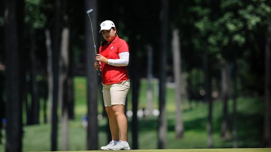 Inbee Park, of South Korea, watches as her putt falls short on the fourth hole during the final round of the International Crown golf tournament Sunday, July 27, 2014, in Owings Mills, Md. (AP Photo/Gail Burton)