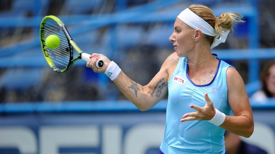 Svetlana Kuznetsova, of Russia, returns the ball against Polona Hercog, of Slovenia, during a match in the Citi Open tennis tournament, Monday, July 28, 2014, in Washington. (AP Photo/Nick Wass)