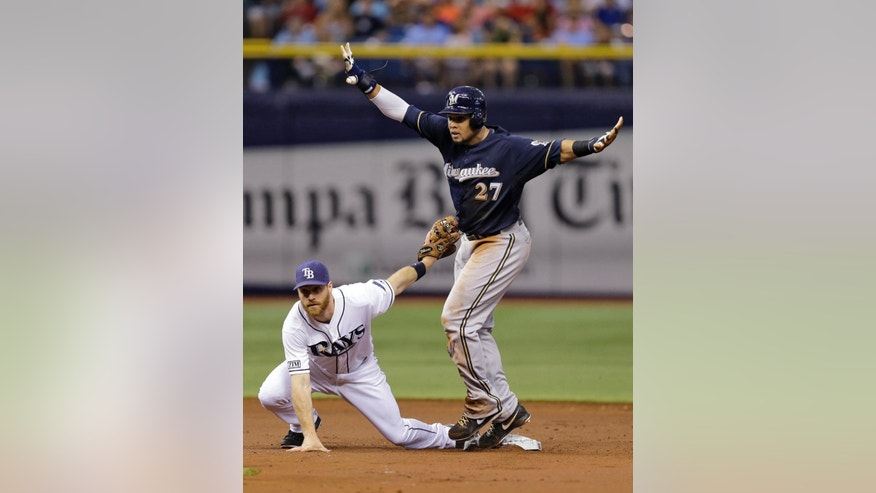 Milwaukee Brewers' Carlos Gomez steals second base ahead of the tag by Tampa Bay Rays second baseman Logan Forsythe during the third inning of an interleague baseball game Monday, July 28, 2014, in St. Petersburg, Fla. (AP Photo/Chris O'Meara)