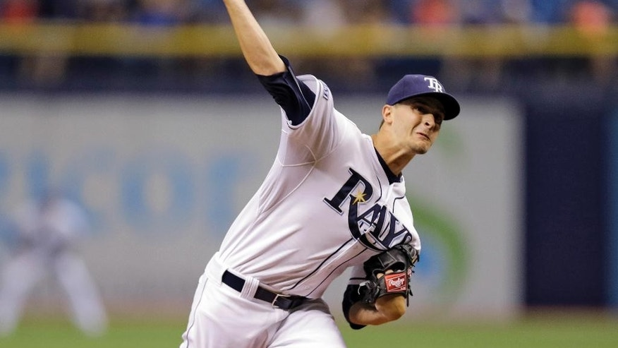 Tampa Bay Rays starting pitcher Jake Odorizzi delivers to the Milwaukee Brewers during the first inning of an interleague baseball game Monday, July 28, 2014, in St. Petersburg, Fla. (AP Photo/Chris O'Meara)