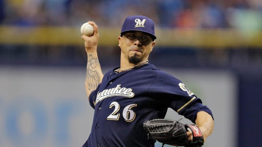 Milwaukee Brewers starting pitcher Kyle Lohse delivers to the Tampa Bay Rays during the first inning of an interleague baseball game Monday, July 28, 2014, in St. Petersburg, Fla. (AP Photo/Chris O'Meara)