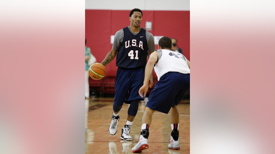 The Chicago Bulls' Derrick Rose dribbles the ball during a USA Basketball minicamp scrimmage Monday, July 28, 2014, in Las Vegas. (AP Photo/John Locher)