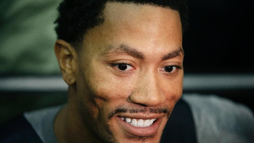 The Chicago Bulls' Derrick Rose speaks with the media after a USA Basketball minicamp practice Monday, July 28, 2014, in Las Vegas. (AP Photo/John Locher)