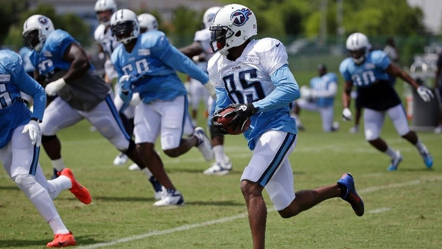Tennessee Titans wide receiver Nate Washington (85) runs the ball during NFL football training camp Monday, July 28, 2014, in Nashville, Tenn. Washington, originally an undrafted free agent, is in his 10th NFL training camp. It also might be his last, at least with the Titans, as he has one season left on his contract. (AP Photo/Mark Humphrey)