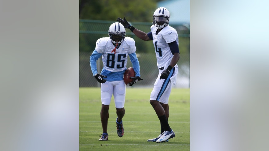 Tennessee Titans wide receiver Nate Washington (85) is congratulated by wide receiver Michael Preston (14) after a play during NFL football training camp Monday, July 28, 2014, in Nashville, Tenn. Washington, originally an undrafted free agent, is in his 10th NFL training camp. It also might be his last, at least with the Titans, as he has one season left on his contract. (AP Photo/Mark Humphrey)