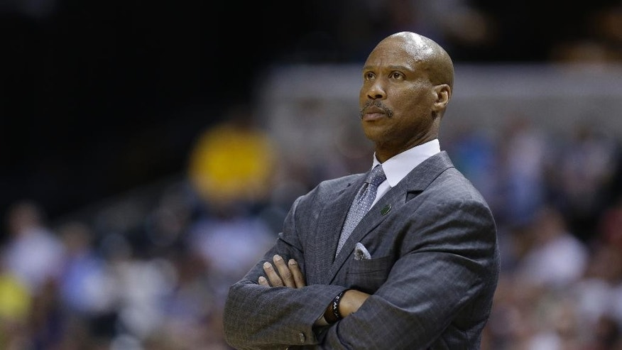 FILE - In this April 9, 2013, file photo, then-Cleveland Cavaliers coach Byron Scott watches the Cavaliers' NBA basketball game against the Indiana Pacers in Indianapolis. Scott said this weekend that he has been hired by the Lakers, but the club insisted Sunday, July 27, 2014, that no deal has been reached. Scott, who won three NBA titles as a shooting guard for the Lakers, told KCBS-TV he will take over the club, which hasn't had a coach since Mike D'Antoni resigned April 30. (AP Photo/Michael Conroy,file)