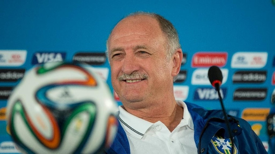 FILE - In this Friday, July 11, 2014 file photo, Brazil's coach Luiz Felipe Scolari smiles during a press conference a day before his team's World Cup third-place soccer match against the Netherlands at the Estadio Nacional in Brasilia, Brazil. Luiz Felipe Scolari, who resigned two weeks ago as Brazil coach, is returning to Gremio for his third stint in charge of the Brazilian team. The club confirmed the appointment on Tuesday July 29, 2014. Scolari first coached the club in 1987 and returned six years later for another stint. (AP Photo/Andre Penner, File)