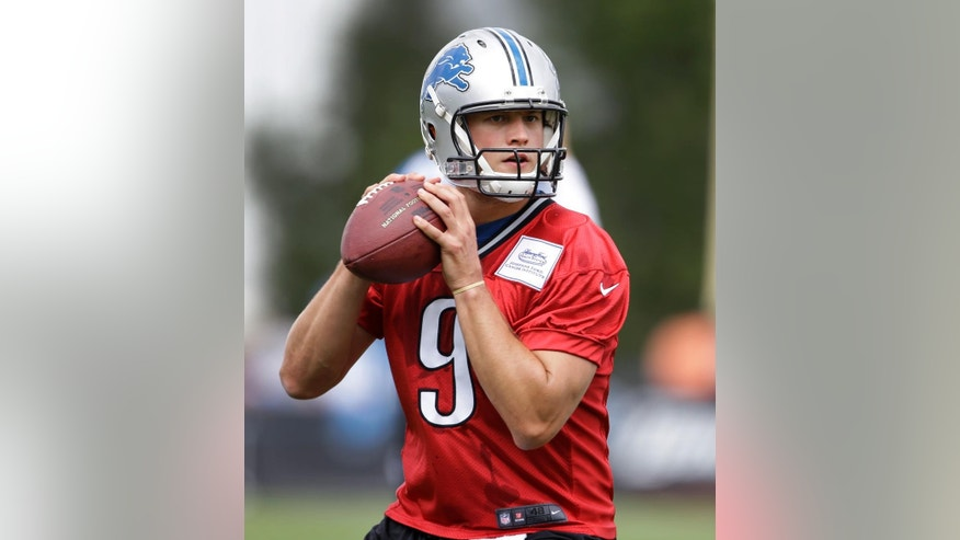 Detroit Lions quarterback Matthew Stafford throws during NFL football training camp in Allen Park, Mich., Tuesday, July 29, 2014. (AP Photo/Paul Sancya)