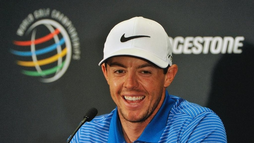 Rory McIlroy of Northern Ireland, responds during an interview, at the World Golf Championships, Bridgestone Invitational,Tuesday, July 29, 2014, in Akron, Ohio. Clark won the Canadian Open last week. (AP Photo/Phil Long)