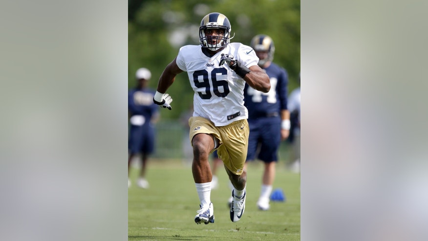 St. Louis Rams defensive end Michael Sam runs as part of a special teams drill during training camp at the NFL football team's practice facility on Friday, July 25, 2014, in St. Louis. (AP Photo/Jeff Roberson)