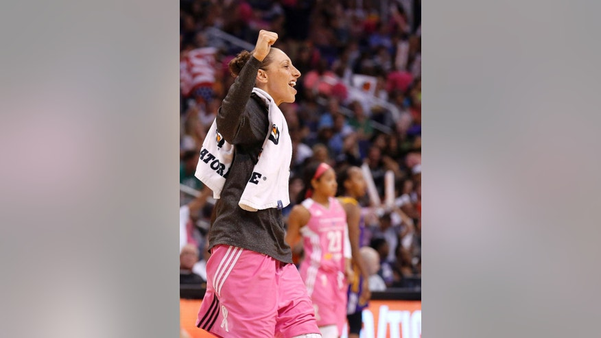 Phoenix Mercury's Diana Taurasi celebrates a score by teammate Mistie Bass against the Los Angeles Sparks during the second half of a WNBA basketball game on Tuesday, July 29, 2014, in Phoenix. The Mercury defeated the Sparks 90-69, winning their 16th straight game. (AP Photo/Ross D. Franklin)