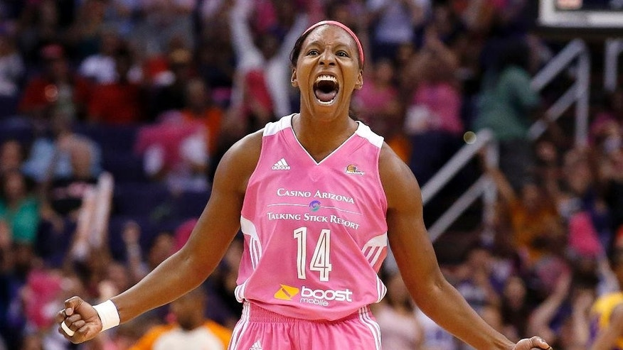Phoenix Mercury's Eshaya Murphy celebrates a score by teammate Mistie Bass against the Los Angeles Sparks during the second half of a basketball game on Tuesday, July 29, 2014, in Phoenix. Mercury won 90-69, winning their 16th straight game. (AP Photo/Ross D. Franklin)