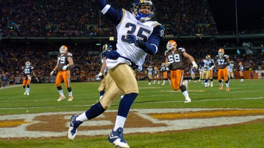 FILE - In this Dec. 8, 2003 file photo, St. Louis Rams' Aeneas Williams celebrates after a 46-yard interception return for a touchdown against the Cleveland Browns, in Cleveland. Aeneas Williams spent most of his pro career on bad teams.That didn't prevent him from pursuing excellence, becoming one of the best cornerbacks in the game and earning a spot in the NFL Hall of Fame.  (AP Photo/Morry Gash, File)