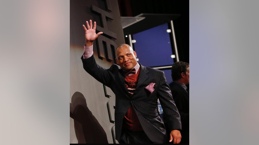 FILE - In this May 9, 2014 file photo, former NFL player Aeneas Williams waves as he is introduced before the start of the second round of the 2014 NFL Draft  in New York. Aeneas Williams spent most of his pro career on bad teams.That didn't prevent him from pursuing excellence, becoming one of the best cornerbacks in the game and earning a spot in the NFL Hall of Fame.  (AP Photo/Jason DeCrow, File)