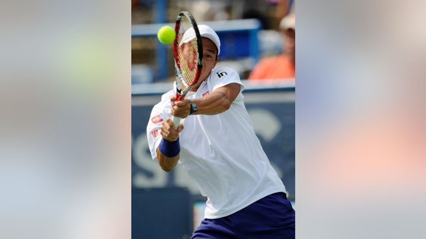 Kei Nishikori, of Japan, returns the ball against Sam Querrey during a match at the Citi Open tennis tournament, Wednesday, July 30, 2014, in Washington. (AP Photo/Nick Wass)