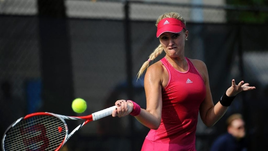 Kristina Mladenovic, of France, swings for the ball against Taylor Townsend during a match at the Citi Open tennis tournament, Wednesday, July 30, 2014, in Washington. (AP Photo/Nick Wass)