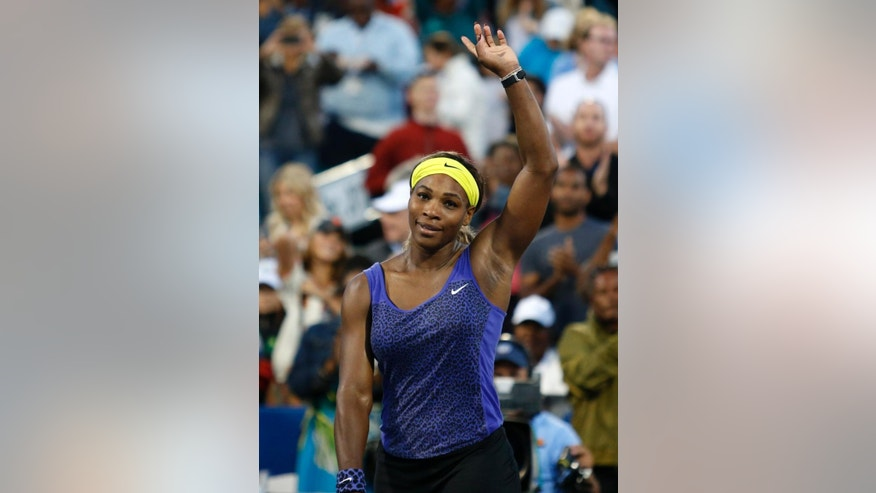 Serena Williams, of the United States, waves after defeating Karolina Pliskova, of the Czech Republic, 7-5, 6-2 in the Bank of the West Classic tennis tournament, Wednesday, July 30, 2014, in Stanford, Calif. (AP Photo/Beck Diefenbach)