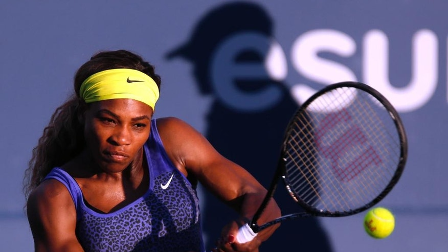 Serena Williams returns the ball during the first set of her match against Karolina Pliskova in the Bank of the West Classic, Wednesday, July 30, 2014, in Stanford, Calif. (AP Photo/Beck Diefenbach)