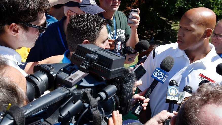 The Pittsburgh Steelers first-round draft choice, linebacker Ryan Shazier, right, talks with reporters after arriving for NFL football training camp at the team training facility in Latrobe, Pa. on Friday, July 25, 2014. (AP Photo/)