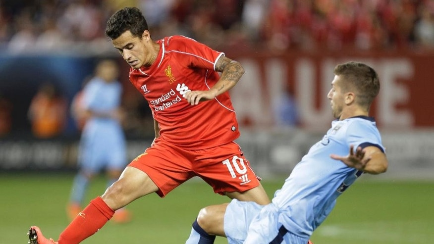 Liverpool's Philippe Coutinho (10) and Manchester City's Matija Nastasic (33) fight for control of the ball in the second half of a Guinness International Champions Cup soccer tournament match  Wednesday, July 30, 2014, in New York. Liverpool won the game 3-2. (AP Photo/Frank Franklin II)
