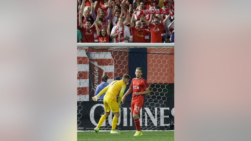 Fans cheer after Liverpool's Lucas Leiva (21) scored a goal on a penalty kick past Manchester City goalkeeper Joe Hart (1) during a Guinness International Champions Cup soccer tournament match Wednesday, July 30, 2014, in New York. Liverpool won the game 3-2 in a penalty kick shootout. (AP Photo/Frank Franklin II)