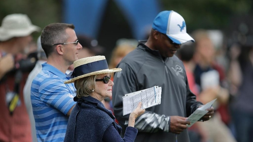Detroit Lions owner Martha Firestone Ford watches practice with president Tom Lewand, left, and head coach Jim Caldwell, right, during NFL football training camp in Allen Park, Mich., Tuesday, July 29, 2014. (AP Photo/Paul Sancya)
