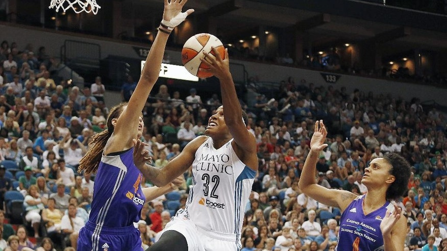 Minnesota Lynx forward Rebekkah Brunson (32) goes up to the basket against Phoenix Mercury center Brittney Griner (42) and forward Candice Dupree in the second half of a WNBA basketball game, Thursday, July 31, 2014, in Minneapolis. The Lynx won 75-67. (AP Photo/Stacy Bengs)
