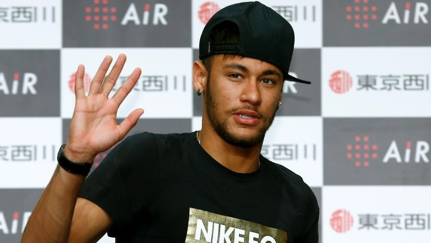 Brazil's soccer player Neymar waves for the media during a press conference at a hotel in Tokyo, Thursday, July 31, 2014. (AP Photo/Shizuo Kambayashi)