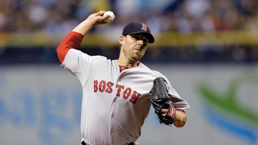 Boston Red Sox starting pitcher John Lackey delivers to the Tampa Bay Rays during the first inning of a baseball game Saturday, July 26, 2014, in St. Petersburg, Fla. (AP Photo/Chris O'Meara)