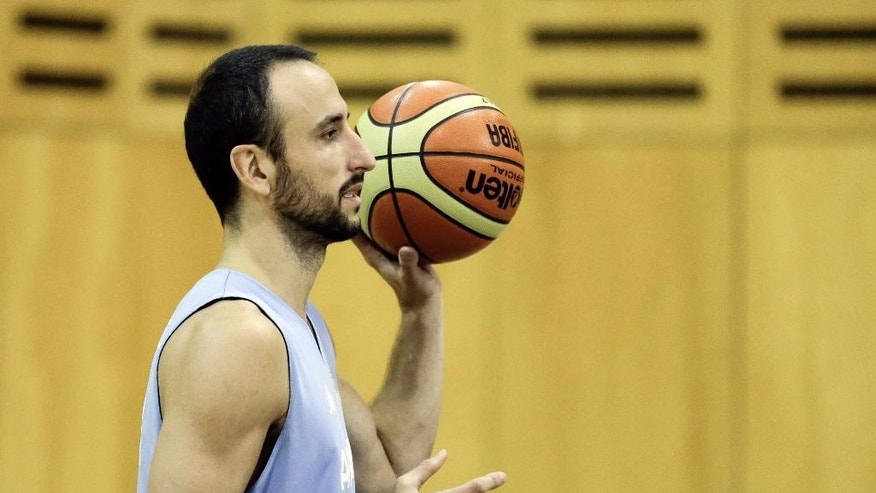Spurs guard Manu Ginobili participates in an Argentina national basketball team practice, in Buenos Aires, Argentina, Wednesday, July 30, 2014. Ginobili has expressed his intent to play for Argentina at the FIBA World Cup despite a stress fracture of the lower fibula of his right leg. It's unclear when Ginobili was injured.  (AP Photo/Victor R. Caivano)