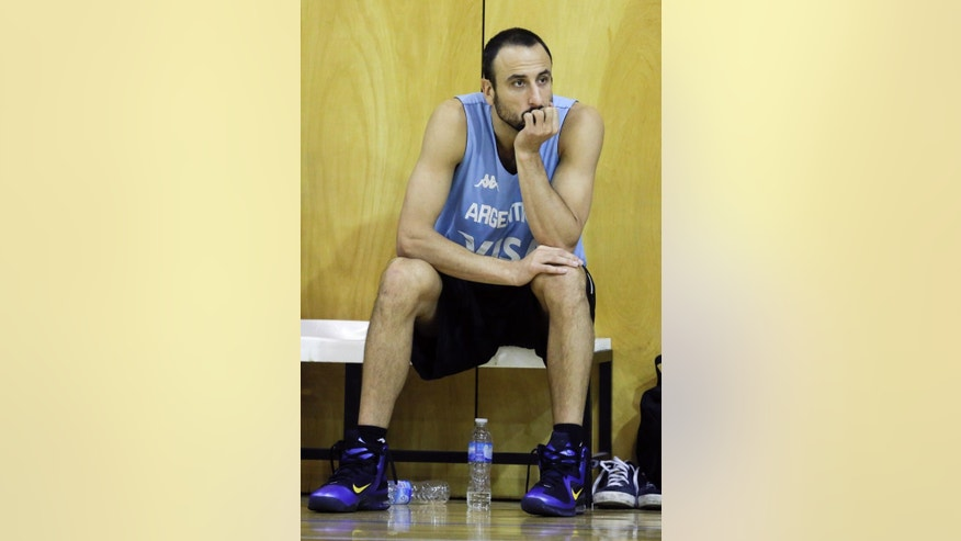 Spurs guard Manu Ginobili watches the Argentina national basketball team practice, in Buenos Aires, Argentina, Wednesday, July 30, 2014. Ginobili has expressed his intent to play for Argentina at the FIBA World Cup despite a stress fracture of the lower fibula of his right leg. It's unclear when Ginobili was injured. (AP Photo/Victor R. Caivano)