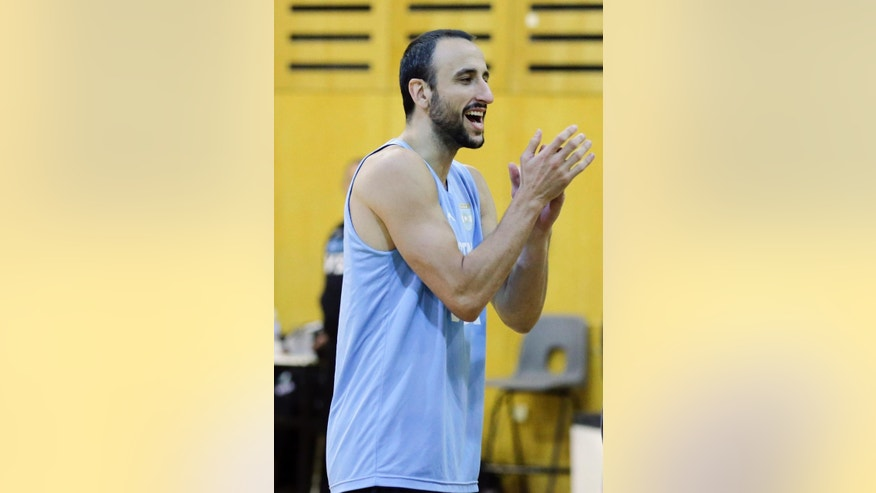 Spurs guard Manu Ginobili claps during an Argentina national basketball team practice, in Buenos Aires, Argentina, Wednesday, July 30, 2014. Ginobili has expressed his intent to play for Argentina at the FIBA World Cup despite a stress fracture of the lower fibula of his right leg. It's unclear when Ginobili was injured.   (AP Photo/Victor R. Caivano)