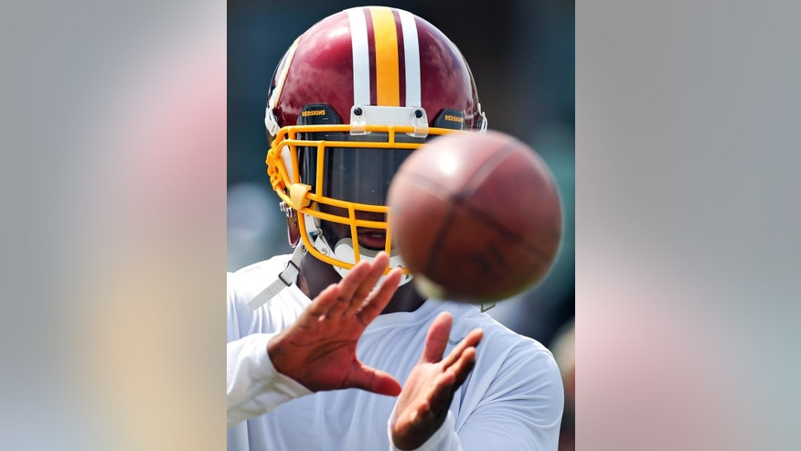 Washington Redskins safety Ryan Clark catches the ball in a drill during NFL football training camp, Saturday, July 26, 2014 in Richmond, Va. (AP Photo/Alex Brandon)