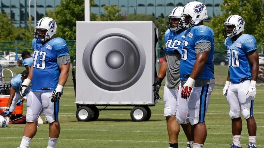 Tennessee Titans players line up for a drill in front of a large speaker during NFL football training camp Thursday, July 31, 2014, in Nashville, Tenn. The team used speakers to simulate crowd noise during practice. (AP Photo/Mark Humphrey)