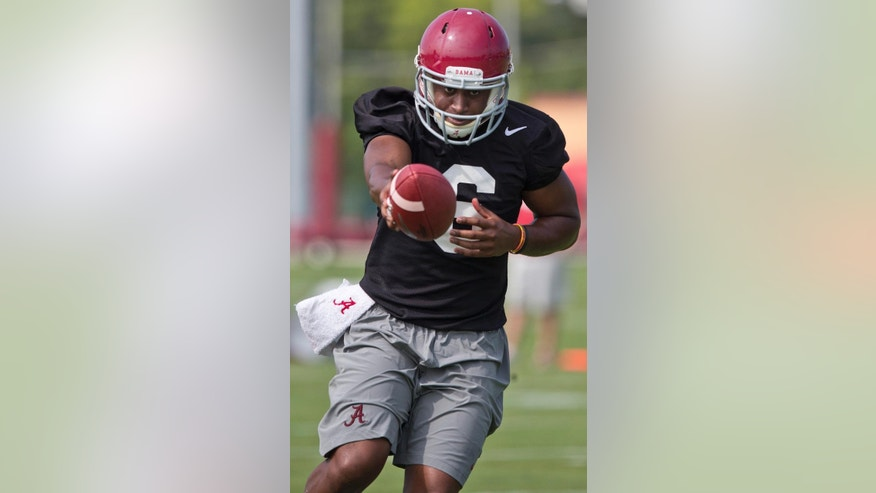 Alabama quarterback Blake Sims (6) handles the ball during an NCAA college football practice, at the Thomas-Drew practice fields on Friday, Aug. 1, 2014, in Tuscaloosa, Ala. (AP Photo/Brynn Anderson)