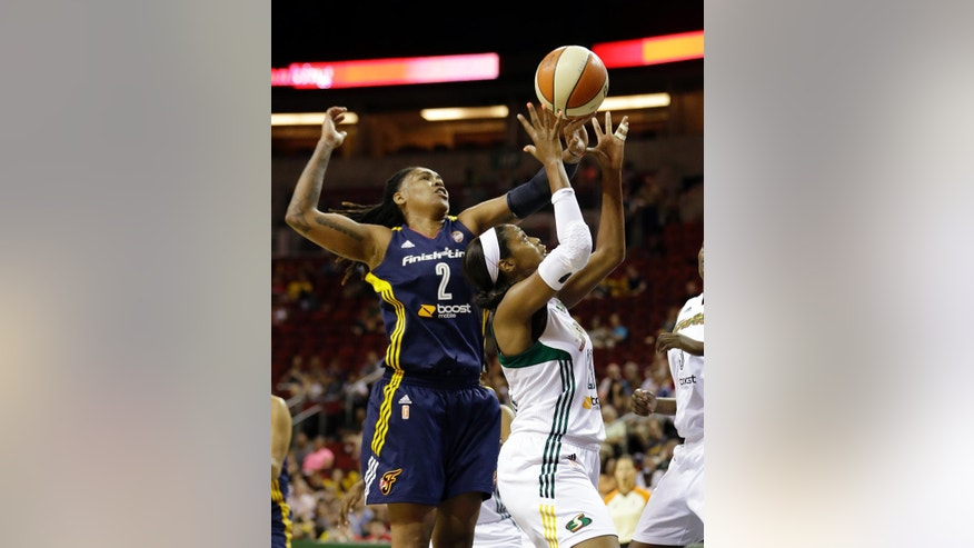 Indiana Fever's Erlana Larkins (2) and Seattle Storm's Camille Little reach for a rebound in the first half of a WNBA basketball game Thursday, July 31, 2014, in Seattle. (AP Photo/Elaine Thompson)