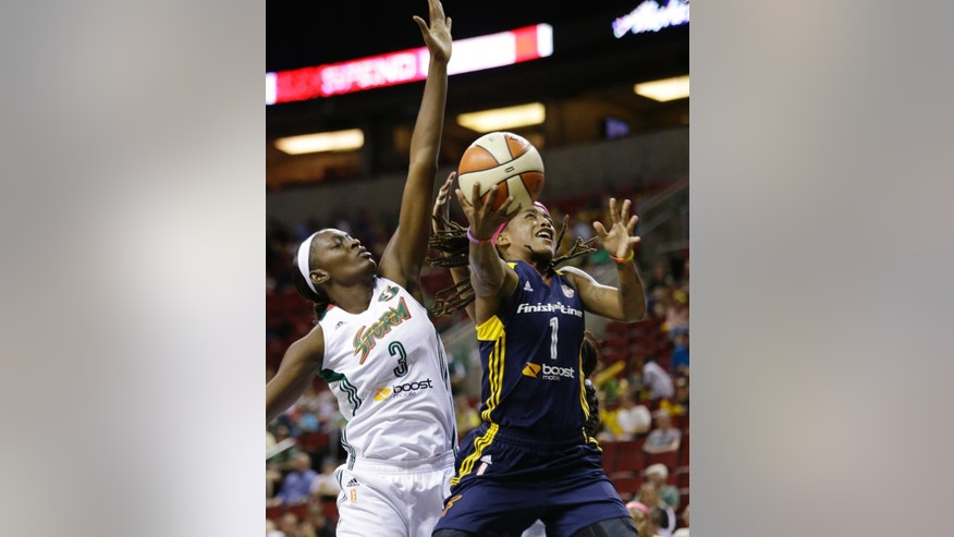 Indiana Fever's Shavonte Zellous (1) shoots as Seattle Storm's Waltiea Rolle follows in the first half of a WNBA basketball game Thursday, July 31, 2014, in Seattle. (AP Photo/Elaine Thompson)