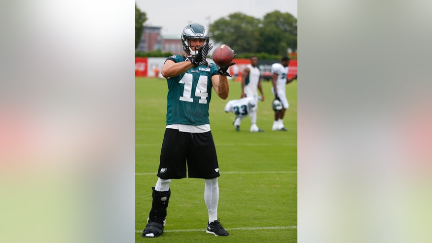 Philadelphia Eagles wide receiver Riley Cooper catches a pass during NFL football training camp Friday, Aug. 1, 2014, in Philadelphia. (AP Photo/Matt Rourke)