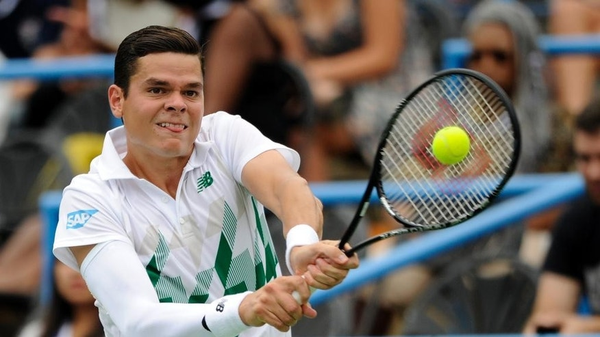 Milos Raonic, of Canada, returns the ball against Steve Johnson during a match at the Citi Open tennis tournament, Friday, Aug. 1, 2014, in Washington. (AP Photo/Nick Wass)