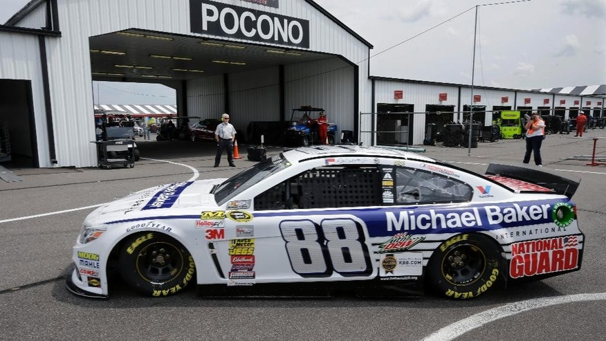 Dale Earnhardt Jr. (88) drives in the garages during practice for Sunday's NASCAR Sprint Cup Series auto race at Pocono Raceway, Friday, Aug. 1, 2014, Long Pond, Pa. (AP Photo/Mel Evans)